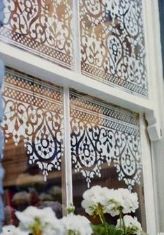 This photograph is from an issue of Victoria magazine (no longer published) and uses the border stencil over three-quarters of the window as if it were a lace panel pulled partially down.  The border is used both right side up and upside down to fill the desired area. When you have several panes on the window it might be a good idea to experiment with your desired pattern layout onto paper first.  The window was stencilled with white acrylic paint which can be removed with solvents if…
