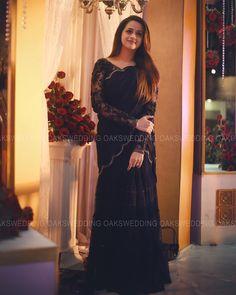 Bhavana in a Midnight Bluie Lehenga Fully Handworked and Enhanced with Frills on Skirt Kerala Saree Blouse Designs, Half Saree Designs, Indian Wedding Gowns, Indian Dresses, Saree Wedding, Ganesha, Engagement Dresses, Kerala Engagement Dress, Satin Saree