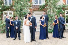 bride and groom kissing with bridal aprty around them by jenny owens photography