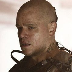 Matt Damon Climbs Into a Robo-Suit for Elysium Photo - The actor walks softly and carries a very big gun in director Neill Blomkamp's follow-up to District 9, in theaters this August.