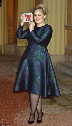 Sleek: Adele pulled out all the stops for her moment at the palace, opting for a Stella McCartney midi gown, and a Phillip Treacy headpiece