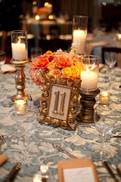 peach wedding centerpiece with gold candle sticks