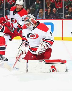 NEWARK, NJ - MARCH 25: Eddie Lack #31 of the Carolina Hurricanes makes a save against the New Jersey Devils during the game at Prudential Center on March 25, 2017 in Newark, New Jersey. (Photo by Andy Marlin/NHLI via Getty Images)