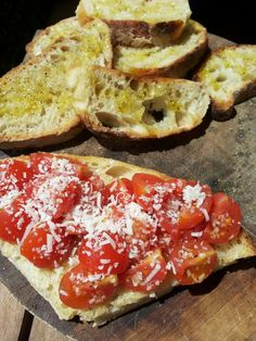 Bruschetta con pomodorini e parmigiano, pane bruscato con olio sale e pepe.  Bruschetta with cherry tomatoes and Parmesan, toasted bread with olive oil salt and pepper.
