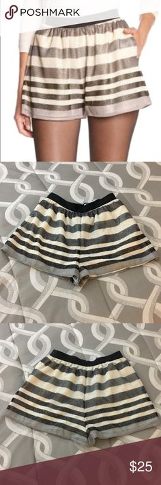 """BCBGeneration Striped Glitter Shorts Cute BCBGeneration Black and Cream Shimmer Striped Shorts.  Adorable worn over black hose with either a pair of black heels or booties.  Back zip hook/eye closure.  When lying flat, waist is 13"""" and length is 13.5"""". Great used condition. Size 6. BCBGeneration Shorts"""