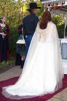 A sheer cape instead of a veil? Neat.