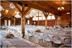 The inside of the barn at Lower Lake Ranch is decorated for a wedding in shades of purple and lavender in the Colorado Mountains. - April O'Hare Photography http://www.apriloharephotography.com #LowerLakeRanch #Pine #Colorado #ColoradoWedding #LowerLakeRanchWedding #RusticWedding #RusticColoradoWedding #RusticMountainWedding #ColoradoMountainWedding #MountainWedding #BarnWedding
