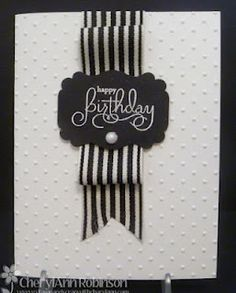 This classy card can be made with embossed-dot paper and a striking black and white striped ribbon.  DIY Birthday card
