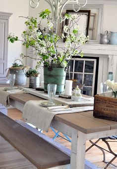 using vintage rustic elements. Explore your thrift shop for items like buckets, wooden boxes and vintage glass.  Add greenery.