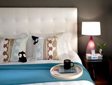 King room complete with a seriously comfy bed and hand-blown custom glass lamps at your bedside!