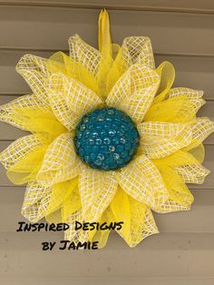 Yellow flower made of deco mesh and gems.