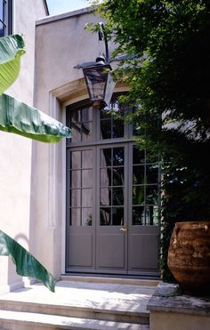 french door by mcalpine, maybe replace large window in front with four narrow french doors similar to these.