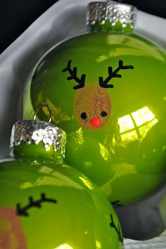 Reindeer Thumbprint Ornaments - my 2 1/2 year old LOVED doing this project! It was fun...medium amount of paint = better thumb prints...I sprayed with clear acrylic afterwards to seal the thumbprints.