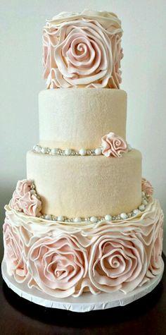 Blush pink wavy wedding cake.