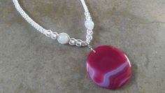 Check out this item in my Etsy shop https://www.etsy.com/listing/219398859/round-pink-agate-hemp-necklace-white