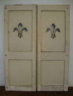 French Shutters with Fleur-De-Lys