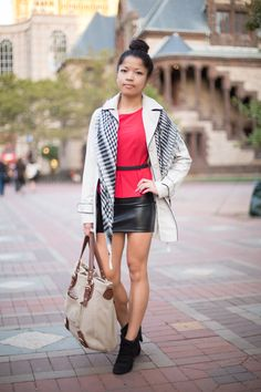 Self Described Style: Cultural & SocialFavorite Store in Boston: MarshallsOccupation: StudentSpotted at: Boylston Street  Black and red is never a bad choice and the black skirt and ankle boots are definitely working! Love the addition of the scarf and the way she wears it loose over the shoulders of her trench.