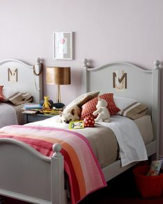 Girls' Bedroom Ideas -  Letter Head  A monogrammed headboard commands attention. Perfect for young royalty.