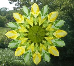 Green and Yellow Sunburst Window Star with 16 by harvestmoonbyhand