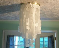 I like this idea, too. I'd think I'd like to use it to make curtains between my dining room and kitchen. Tedious, but simple.