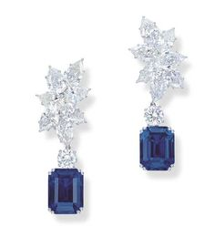AN IMPORTANT PAIR OF SAPPHIRE AND DIAMOND EAR PENDANTS Each cut-cornered rectangular-cut sapphire weighing 14.66 and 16.12 carats, to a circular-cut diamond surmount weighing 1.01 and 1.01 carats, suspended from a detachable foliate cluster of seven pear-shaped diamonds weighing from 1.00 to 1.29 carats, mounted in platinum, 5.0 cm long