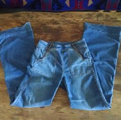 "Free People Blank NYC Denim Jeans Double zip soft blue jeans with stretch Size 27 Blank NYC Cute flare slightly bell/wide leg but not dramatic. Meant to sit high waisted 70s vibe Well worn, hems are both quite worn (dragged on me a bit if not wearing tall shoes) one is especially in need of attention and a bit busted in an area. Shown in close up pic.  77% cotton/27% poly/2% spandex Lots of stretch, probably best for m Shown on 5'8"" size small. Inseam approx 34"" Free People Jeans Flare…"