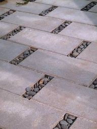Openings between each paver makes room for a permeable detail of smoth stones.