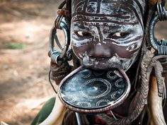 Africa | Portrait of a young Mursi woman. Omo Valley, Ethiopia | © maramarenka, via flickr