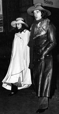 Bianca & Mick Jagger | rolling stones | serious | stroll | lovers | matching hats | coats | long jackets | rock stars
