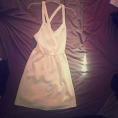 White very pretty cross back dress. Never worn just never found the occasion to wear it but it's very pretty with a cross back straps. Also open to negotiation Charlotte Russe Dresses Midi