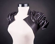 The ruching in full sleeves would really look great, the button detail and back make this satin bolero great addition to the dress.  CREATIVE Unique Leather inspired Bolero by uniquastudio on Etsy, $62.00