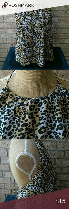 Animal Print Halter Top Alice + Olivia leopard print halter top. High neckline with drawstring tie allows you to adjust placement at neckline. Low back for added sexiness. Beautiful gold lining. Size M. Top is 100% silk with 95% silk/ 5% spandex lining. Dry clean only. EUC. Alice + Olivia Tops Camisoles