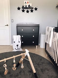 The layers of monochrome color in this nursery are so good. We love how the black dresser pops on the light gray wall.