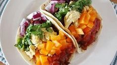 CHORIZO AND EGG RAINBOW TACOS Taste the rainbow for breakfast, lunch or any time you just want a tasty taco in two shakes.