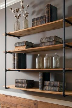 In addition to the living room's built-in shelves, this free-hanging industrial shelving installed on the opposing wall provides additional display space while tying in visually with the kitchen's open shelving.