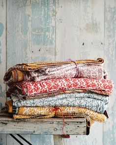 "Chirali bedspread: ""Artisan-made, block printed bedspread from India. Made from layers of recycled sari material quilted together with running kantha stitch."" 