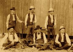 This photo shows the transition to more advancing technology; these Winchester warriors wear cartridge belts stuffed with modern-era smokeless powder rifle cartridges. (Standing, from left) Herff Alexander Carnes, Sam McKenzie and Arthur Beech. (Seated, from left) Tom Ross, Albert Mace and John R. Hughes.  Courtesy Texas Ranger Research Center, Texas Ranger Hall of Fame & Museum
