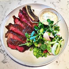 New dish: 500g longhorn rib eye from Thirsk, raw summer salad, & sauce gribiche. For 2-3 (bring your friends ) #newmenu #summermenu #ribeye #gribiche #duckandwaffle #london #summer
