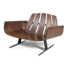 Great curves on this Jorge Zalszupin chair. This would be awesome for new screened in porch! #modern #furniture