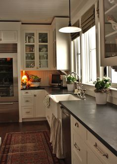 kitchens - Benjamin Moore - White Dove - Perrin and Rowe Gooseneck Bridge Kitchen Faucet soapstone countertops gray skirted farmhouse sink white glass-front kitchen cabinets painted Benjamin Moore White Dove beadboard backspalsh ceiling
