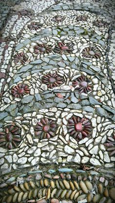 Pebble mosaic detail by Glen Andersen http://www.mosaicplanet.net at the entrance of Firehall Arts Centre, Vancouver, Canada. Photo: http://firehallartscentre.ca blog.
