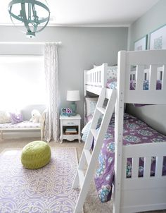 girls room bunk beds with a cute little nightstand - love the soothing color palette yet grown up prints