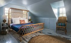 In this beachy bedroom, the curved rattan bed is from Anthropologie, and the rattan chair is from Serena & Lily