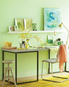 great combination: pale green walls with cool-toned artwork