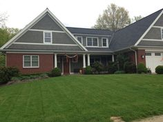 red brick houses with siding- love the grey siding color and white trim