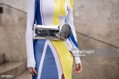 A guest poses with an Off White waist bag after the Akris show at the Palais de Tokyo during Paris Fashion Week Womenswear FW 18/19 on March 4 2018...