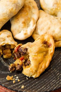 NYT Cooking: Many cultures have put a spin on the empanada. This recipe descends from the Argentine way of making these little meat pies. The Argentine empanada is small, just two or three delicious bites. The technique to master in this recipe is holding the open empanada with one hand and using the other hand to crimp the outer edge and for a decorative braid. The less dexterous among us should use a fork...