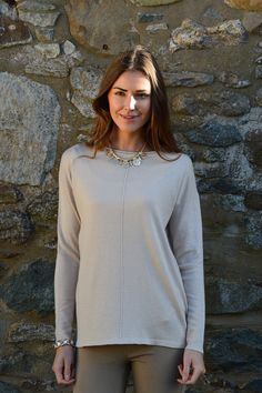 Happy Kinda Life - A jumper that you will wear again and again, fabulously versatile.  A so now high low hem for a modern spin on the classic round neck jumper, it's a flattering, curve skimming effect in a soft cotton blend.