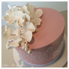Dusty pink cake stencilled with ivory Royal icing and finished with sugar poppies.