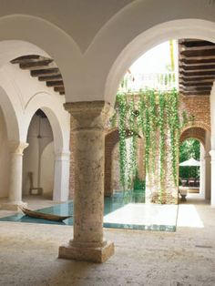 Coralline Stone Column: Foreground, original column of coralline stone indigenous to region. Mediterranean Architecture, Architecture Details, Living Pool, Outdoor Living, Beautiful Homes, Beautiful Places, Stone Columns, My Pool, Cool Pools